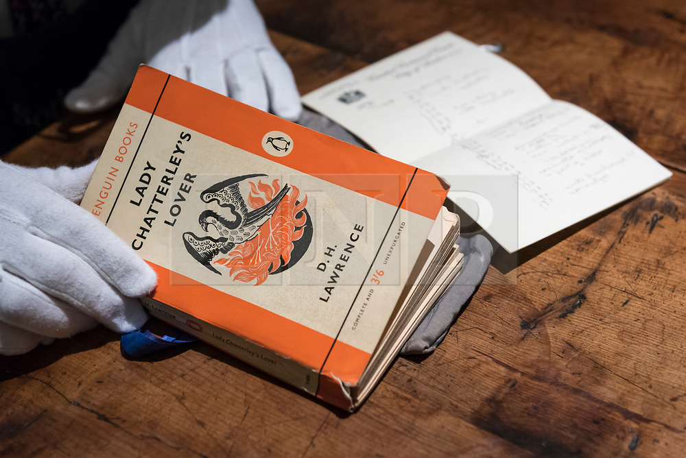 """© Licensed to London News Pictures. 26/10/2018. LONDON, UK. A technician presents """"The Judge's copy from the 1960 obsecenity trail, annotated by him and his wife"""", D.H. Lawrence's Lady Chatterley's Lover (Est GBP10,000-15,000).   Preview of """"A Private View, property from the country home of Christopher Cone and Stanley J. Seeger"""" at Sotheby's, New Bond Street.  Over 200 extraordinary works will be auctioned in London on 30 October 2018.  Photo credit: Stephen Chung/LNP"""