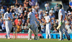 Pakistan's Asad Shafiq celebrates reaching his century during day two of the Fourth Investec Test match at The Kia Oval, London.