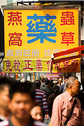 HONG KONG - MARCH 03: A banner with Chinese script above the crowd in Mong Kok busy neighborhood, on March 3, in Hong Kong. (Photo by Lucas Schifres/Pictobank)