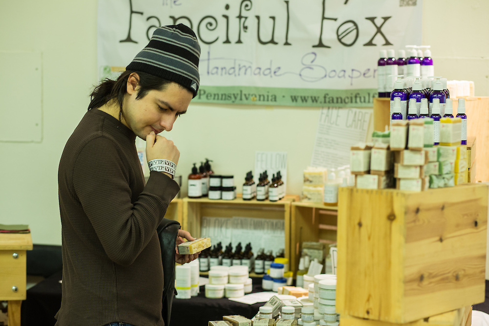 A visitor checking out handmade soaps at the Fanciful Fox at the Vegetarian Food festival.