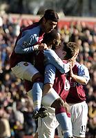 Photo: Richard Lane.<br /> Aston Villa v Birmingham City. Barclaycard Premiership. 22/02/2004.<br /> Juan Pablo Angel and Gareth Barry celebrate with Villa goal scorer, Darius Vassell.