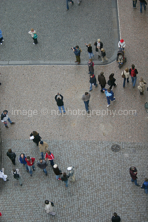 View of people on the pavement, from the tower on Charles bridge, Prague city, Czech Republic<br />