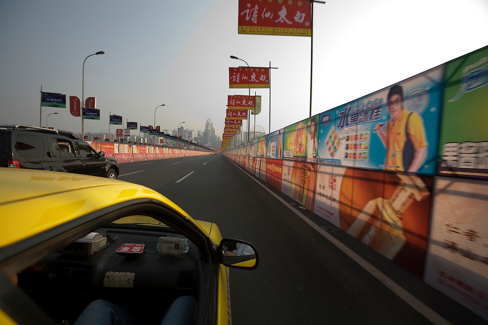 Colorful posters decorate the Changjiang Bridge heading into Chongqing city on 20 March 2007.