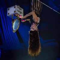 Artist Maria Graziella Galan Bueno performs upside down hanging from the ceiling during the premiere of the new show titled Lights of the Universe in Budapest, Hungary on October 05, 2013. ATTILA VOLGYI