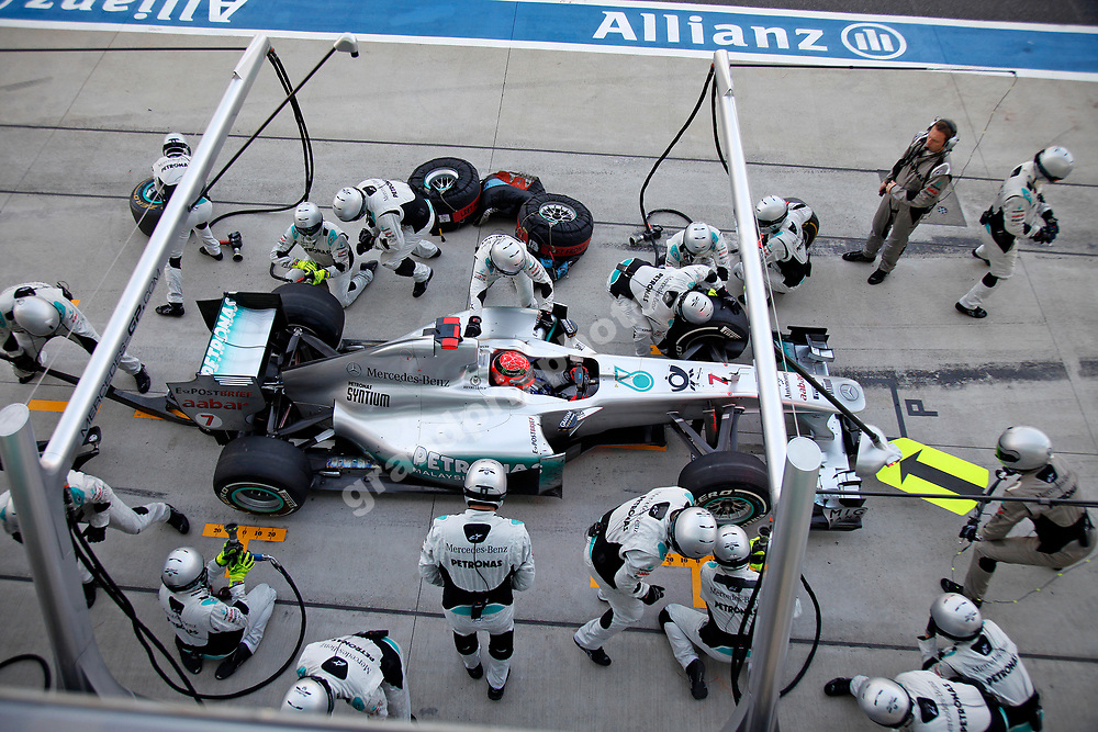 Pit-stop for Michael Schumacher (Mercedes) in the 2011 Japanese Grand Prix in Suzuka. Photo: Grand Prix Photo