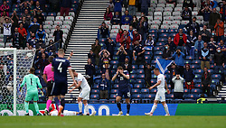 Scotland fans react following an attempt on goal during the UEFA Euro 2020 Group D match at Hampden Park, Glasgow. Picture date: Monday June 14, 2021.