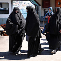 Istanbul, Turkey July 2005<br /> Veiled women coming out a ferry.<br /> Photo: Ezequiel Scagnetti
