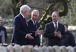 The Prince of Wales (centre) and First Minister of Wales Carwyn Jones (left) leave the Aberfan Memorial Garden in Wales, during a visit to the village on the 50th anniversary of the Aberfan disaster.