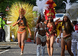 © Licensed to London News Pictures. 29/08/2016. London, UK. Carnival goers in costume waiting to take part in  day two of the Notting Hill carnival, the second largest street festival in the world after the Rio Carnival in Brazil, attracting over 1 million people to the streets of West London.  Photo credit: Ben Cawthra/LNP