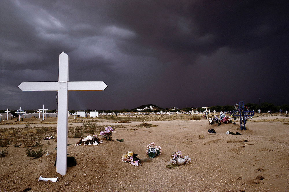 Tucson, Arizona. San Javier Del Bac Mission. Approaching afternoon thunderstorm in graveyard of mission.