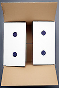 a shipping carton box with blue dots