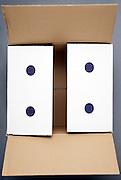 a shipping carton box with blue dots