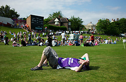 "© Licensed to London News Pictures. 13/07/2013<br /> <br /> Durham City, England, United Kingdom<br /> <br /> A man rests on the grass after marching to the Racecourse during the Durham Miners Gala.<br /> <br /> The Durham Miners' Gala is a large annual gathering held each year in the city of Durham. It is associated with the coal mining heritage of the Durham Coalfield, which stretched throughout the traditional County of Durham, and also gives voice to miners' trade unionism. <br /> <br /> Locally called ""The Big Meeting"" or ""Durham Big Meeting"" it consists of banners, each typically accompanied by a brass band, which are marched to the old Racecourse, where political speeches are delivered. In the afternoon a Miners' service is held in Durham Cathedral <br /> <br /> Photo credit : Ian Forsyth/LNP"