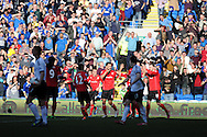Cardiff city's Steven Caulker (4 ,c) celebrates after he scores his sides 1st  goal.   Barclays Premier league, Cardiff city v Fulham at the Cardiff city Stadium in Cardiff , South Wales on Sat 8th March 2014. pic by Andrew Orchard, Andrew Orchard sports photography