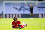 CORRECTION Barnsley forward Jacob Brown (7) on the ground following a challenge, Barnsley goalkeeper Jack Walton (13) protests to the referee in the background, during the EFL Sky Bet Championship match between Queens Park Rangers and Barnsley at the Kiyan Prince Foundation Stadium, London, England on 20 June 2020.