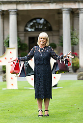 A hundred guests including celebrities, Christopher Biggins, Linda Robson and Bjorn Again take part in the Princes Trust fund-raising event, Lunch with an Old Bag.<br /> <br /> 2018 marks Scotland's Year of Young People and is Lunch with an Old Bag's 10th anniversary - last year the event raised over £700,000. The bags being auctioned this year include a £24,000 Hermes handbag<br /> <br /> Pictured: Linda Robson with a selection of the bags being auctioned