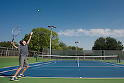 Hugo Moebel, 12, serves to Andrew Ward, 11, as the two practice at the Samuell Grand Tennis Center in Dallas, Texas on August 19, 2014. (Cooper Neill for The New York Times)