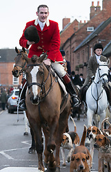 © Licensed to London News Pictures. 26/12/2013. Market Bosworth, Leicestershire, UK. The tradditional Market Bosworth Hunt meet took place today.Pictured, the Hunt makes it's way through the Town Centre. Photo credit : Dave Warren/LNP