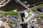 Nederland, Groningen, Delfzijl, 01-05-2013; haven Delfzijl met Damsterhaven en sluis Eemskanaal. Zeedijk met coupure.<br /> Delfzijl harbor with shipping lock. Seawall.<br /> luchtfoto (toeslag op standard tarieven);<br /> aerial photo (additional fee required);<br /> copyright foto/photo Siebe Swart