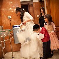 Rahel Berdugo changes her high heel shoes during her wedding ceremony in Jerusalem.
