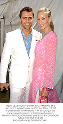 Model LISA BUTCHER and MR BENJAMIN HART at a polo match in West Sussex on 20th July 2003.PLP 267