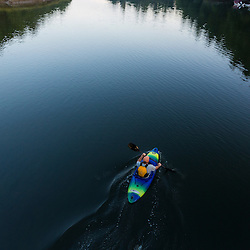 A kayaker enjoys an early morning paddle on the York River in York, Maine.