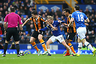 Harry Maguire of Hull City and Tom Davies of Everton battle for the ball. Premier league match, Everton v Hull city at Goodison Park in Liverpool, Merseyside on Saturday 18th March 2017.<br /> pic by Chris Stading, Andrew Orchard sports photography.