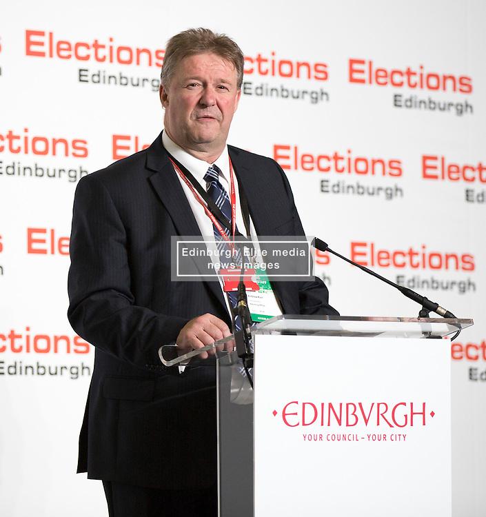 Scottish Parliament Election 2016 Royal Highland Centre Ingliston Edinburgh 05 May 2016; Andrew Kerr, the Returning Officer, begins the postal count during the Scottish Parliament Election 2016, Royal Highland Centre, Ingliston Edinburgh.<br /> <br /> (c) Chris McCluskie | Edinburgh Elite media