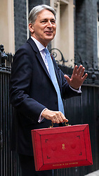 © Licensed to London News Pictures. 29/10/2018. London, UK. The Chancellor of The Exchequer Philip Hammond with the red dispatch box as he leaves 11 Downing Street before delivering the budget in Parliament. Photo credit: Rob Pinney/LNP