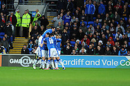 Peterborough's players mob Michael Bostwick © as they celebrate his  opening goal from a free-kick. NPower championship, Cardiff city v Peterborough Utd at the Cardiff city stadium in Cardiff, South Wales on Sat 15th Dec 2012. pic by Andrew Orchard, Andrew Orchard sports photography,