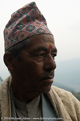 A local along the route on daay-7 of our Himalayan Heroes adventure riding from Tatopani to Pokhara, Nepal. Monday, November 12, 2018. Photography ©2018 Michael Lichter.
