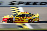 NASCAR Sprint Cup Series auto racing driver Joey Logano takes a practice lap at Kansas Speedway in Kansas City, Kan., Saturday, Oct. 17, 2015. (AP Photo/Colin E. Braley)