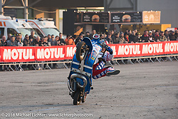 Stunting Vespa performing during Motor Bike Expo. Verona, Italy. January 23, 2016.  Photography ©2016 Michael Lichter.