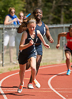 Merrimack Valley's Julianah Adejuyigbe passes the baton to Meredith Ramsey in the womens 4 x 100 meter relay during the Merrimack Valley Invitational Saturday.   (Karen Bobotas/for the Concord Monitor)