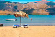 Beach & sunbeds on Agrostoli Bay near Lixouri, Kefalonia, Ionian Islands, Greece. .<br /> <br /> Visit our GREEK HISTORIC PLACES PHOTO COLLECTIONS for more photos to download or buy as wall art prints https://funkystock.photoshelter.com/gallery-collection/Pictures-Images-of-Greece-Photos-of-Greek-Historic-Landmark-Sites/C0000w6e8OkknEb8