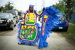 29 August 2014. Lower 9th Ward, New Orleans, Louisiana. <br /> Survivors of the storm. Mardi Gras Indian Robert 'Flag Boy Slim' Stevenson of the Hard Head Hunters leads a touching second line parade along Tennessee Street in the Lower 9th Ward in memory of those who perished in the storm 9 years ago. <br /> Photo; Charlie Varley/varleypix.com
