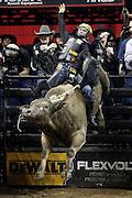 Jess Lockwood rides SweetPro's Long John during the Professional Bull Riders, Built Ford Tough Series at the Sprint Center, Saturday, Feb. 11, 2017, in Kansas City, Mo. (AP Photo/Colin E. Braley)