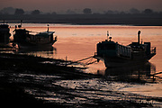 Riverboats at sunrise on Chindwin River, Monywa, Myanmar