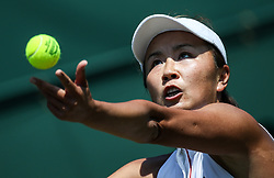 LONDON, July 3, 2018  Peng Shuai of China serves during the women's singles first round match against Samantha Stosur of Australia at the Championship Wimbledon 2018 in London, Britain, on July 3, 2018. Samantha Stosur won 2-0. (Credit Image: © Tang Shi/Xinhua via ZUMA Wire)