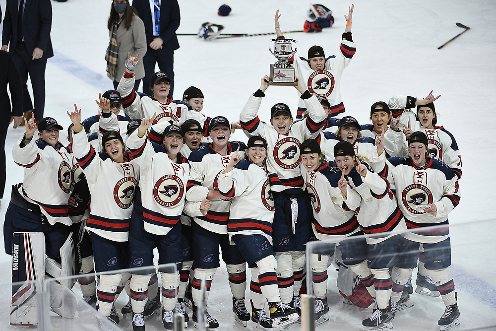 ERIE, PA - MARCH 06: The Robert Morris Colonials celebrate after defeating the Syracuse Orange 1-0 in the CHA Championship Game at the Erie Insurance Arena on March 6, 2021 in Erie, Pennsylvania. (Photo by Justin Berl/Robert Morris Athletics)