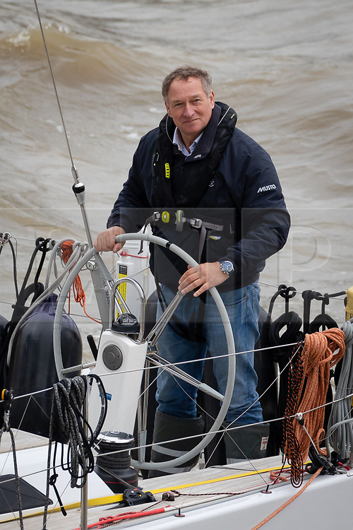© Licensed to London News Pictures. 20/03/2019. London, UK.  Adventurer Sir David Hempleman-Adams sails his yacht, Chione underneath Tower Bridge in London to launch his attempt to sail solo to New York to raise awareness of the St John Ambulance charity.  The record-breaking 62-year-old, who inspired the likes of Bear Grylls and Ben Fogle with his fearless expeditions, says his Voyage of Discovery #DiscoverSJA will be harder than climbing Everest. Photo credit: Vickie Flores/LNP