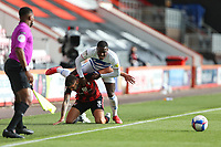 Football - 2020 / 2021 Sky Bet Championship - AFC Bournemouth vs. Queens Park Rangers - The Vitality Stadium<br /> <br /> Bournemouth's Steve Cook fouls Bright Osayi-Samuel of Queens Park Rangers as the pair tussle for the ball during the Championship match at the Vitality Stadium (Dean Court) Bournemouth <br /> <br /> COLORSPORT/SHAUN BOGGUST