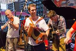 June 17, 2017 - London, London, UK - LONDON, UK.  Brendan Cox (centre), husband of murdered MP, Jo Cox plays in his folk band, the Diddly Dee at The Great Get Together at Tower Bridge Moorings in London last night, 17th June 2017. Friends and residents from Hermitage Moornings, where Jo Cox lived on a houseboat with her husband and two children visited residents and friends at Tower Bridge moorings on the River Thames. (Credit Image: © Vickie Flores/London News Pictures via ZUMA Wire)