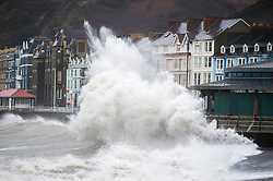 © London News Pictures. 26/01/2016. Aberystwyth, UK. Gale force winds and torrential rain hit the coast at Aberystwyth in West Wales as the remains of Storm Jonas reach UK today (Tues). Up to 100mm (4 inches) of rain are forecast to fall in some exposed upland parts of the country  in the next 48 hours. Photo credit: Keith Morris/LNP