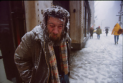 A homeless man battles the cold during a blizzard, 13/03/1993