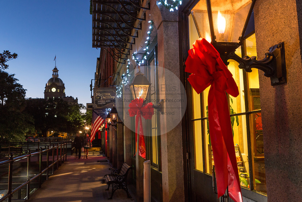 Christmas lights decorate the Riverfront with the City Hall in historic Savannah, GA.