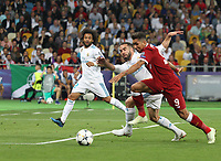 KIEV, UKRAINE - MAY 26: Marcelo and Dani Carvajal of Real Madrid try to stop Roberto Firmino of Liverpool during the UEFA Champions League final between Real Madrid and Liverpool at NSC Olimpiyskiy Stadium on May 26, 2018 in Kiev, Ukraine. (MB Media)