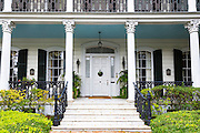 Traditional double gallery grand mansion house with columns and porch in the Garden District of New Orleans, Louisiana, USA