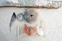 Still Life Photography. Reike Healing energy still life photography with seagull feather seashells and Lemurian crystals and quartz stones. Pink Quartz crystals carry the message of Ancient Lemuria.
