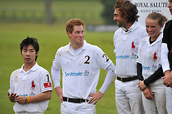 HRH PRINCE HARRY (White shirt no2) at the Sentebale Polo Cup held at Coworth Park, Berkshire on 12th June 2011.